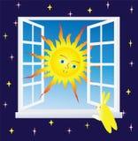 The Sun i fönstret Arkivfoto