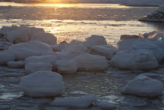 Sun and ice. Pile of ice in the sunset Stock Photography