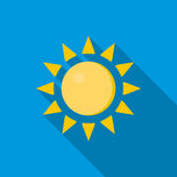 Sun icon in flat style. On a blue background Stock Images