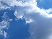 Sun illuminates the clouds. Blue sky, the sun illuminates the clouds stock photography