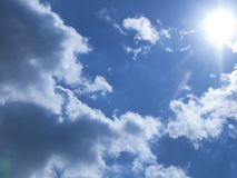 Sun illuminates the clouds. Blue sky, the sun illuminates the clouds stock image