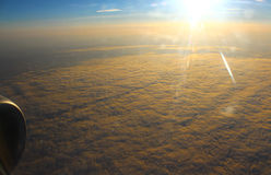 The sun illuminates the clouds, view from altitude Royalty Free Stock Photos