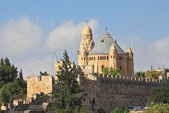 The sun illuminates the dome. The Church  in Jerusalem. Battlements of Jerusalem surrounded by majestic building. The morning sun illuminates the dome Stock Photography