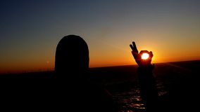 Sun im Schattenbild Stockbilder
