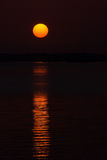 Sun and its Reflection in the Sea Stock Images