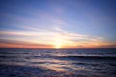 Colorful sunrise reflecting over the ocean royalty free stock photos