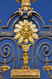 The Sun king, detail of the metal gate of the Chateau de Versailles, Paris Stock Photography