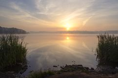 Sun and lake. Water and sky in fine colors stock image