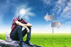 The sun in lamp man and empty signposts on landscapes background Stock Photo