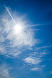 Sun with lens flare, on blue sky background. Royalty Free Stock Images