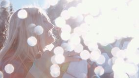 Sun lens, young lovely couple kissing on the bright sunshine. Romantic atmosphere. Being happy together. Playful mood stock video