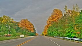 Sun light across top of the trees. Drive to clarksville Stock Photography