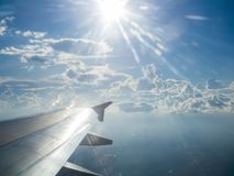 Sun light and air plane wing. In the sky Royalty Free Stock Image