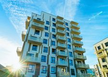 Sun light and Apartment house and home residential building architecture. Concept. Place for copy space. Blue sky stock photo