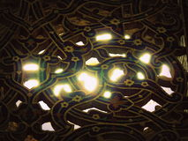 Sun light beams through floral window mosaics at Isfahan mosque Royalty Free Stock Photos