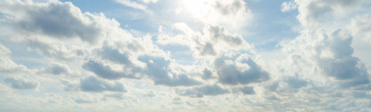 Sun light behind the cloud and blue sky Royalty Free Stock Image