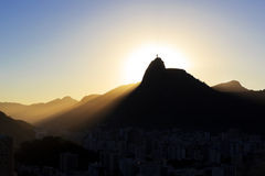 Sun light behind Mountain Corcovado Christ the Redeemer, sunset, Royalty Free Stock Photography