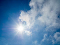 Sun light with blue sky. And clouds Stock Image