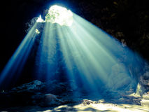 Sun light in the cave. Abstract sun light in the cave background Stock Images