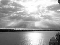 Sun light. Clouds black and white Royalty Free Stock Image