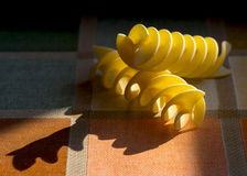 Sun light drawing shadows with italian pasta Royalty Free Stock Photos
