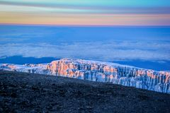 Sunrise on top of Mount Kilimanjaro. Sun light falling on the glaciers on top of Mount Kilimanjaro at sunrise Stock Images