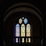 Sun light through the leaded pane in old majestic church Stock Images