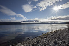 Sun light over lake te anau fiordland national park new zealand Royalty Free Stock Photo