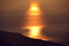 Sun light reflection in sea water at sunrise time Royalty Free Stock Photography