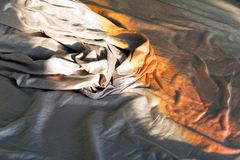 Sun light on the sheets of a bed Stock Image