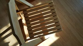 Sun light shine on the wooden chair. Royalty Free Stock Images