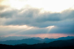 Sun light. Sun shines through the clouds, the mountains Royalty Free Stock Photo