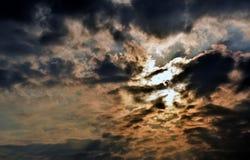 Sun light shining through the dark cloud.  Stock Photos