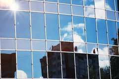 Sun light sky cloud reflection in glass office building Stock Images