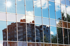 Sun light sky cloud reflection in glass office building Royalty Free Stock Images