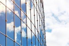 Sun light sky cloud reflection in glass office building Stock Photos