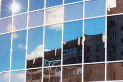 Sun light sky cloud reflection in glass office building Royalty Free Stock Photography