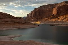 Sun setting over a cove at Lake Powell 2 royalty free stock photo