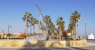 Sun light valencia beach boat fountain 4k spain. Spain sun light valencia beach boat fountain 4k stock video