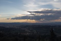 Sun lights break through clouds, Tuscany, Italy royalty free stock images