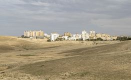 The Sun Lights up the Israeli City of Arad on a Cloudy Day royalty free stock photography