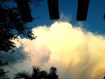 Sun lit clouds Royalty Free Stock Photo