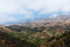 View of a foggy valley with mountains in the distance royalty free stock images