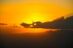 Sun looking like the dragon eye. Stock Photos