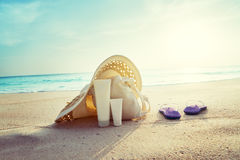 Sun lotion, hat  with bag at the beach Stock Photo