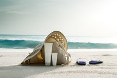 Sun lotion, hat  with bag at the beach Stock Images