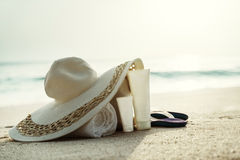 Sun lotion, hat  with bag at the tropical beach Royalty Free Stock Photos