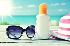 Sun lotion and sunglasses Stock Photography