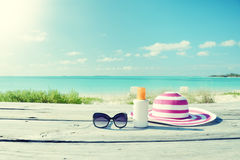Sun lotion and sunglasses Royalty Free Stock Photo