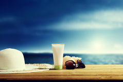 Sun lotion and sunglasses Stock Photo